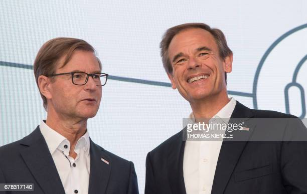 Volkmar Denner CEO of German technology concern Bosch shares a smile with CFO Stefan Asenkerschbaumer during the company's annual press conference at...