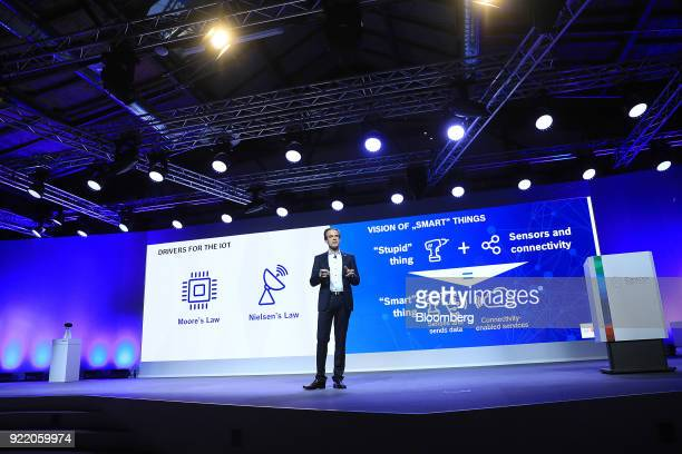 Volkmar Denner chief executive officer of Robert Bosch GmbH gestures while delivering a keynote speech at the Bosch Internet of Things conference in...
