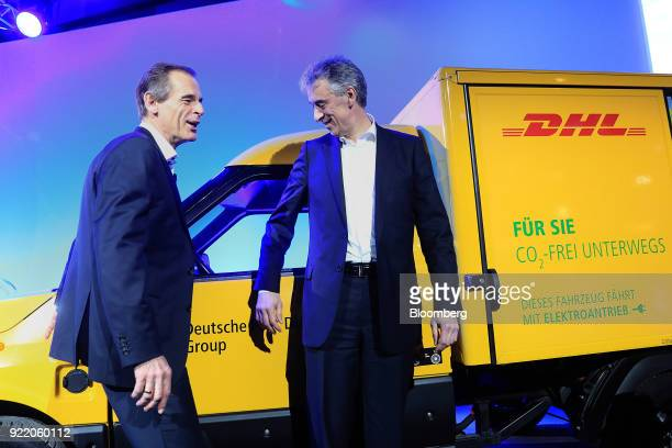Volkmar Denner chief executive officer of Robert Bosch GmbH left and Frank Appel chief executive officer of Deutsche Post AG stand beside a DHL...
