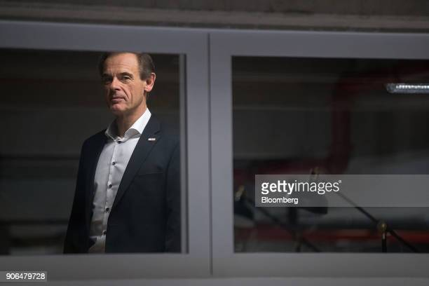 Volkmar Denner chief executive officer of Robert Bosch GmbH looks on as the industrial engineering company opens an Internet of Things center in...