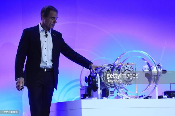 Volkmar Denner chief executive officer of Robert Bosch GmbH stands beside a a Bosch electric automobile axle while delivering a keynote speech at the...