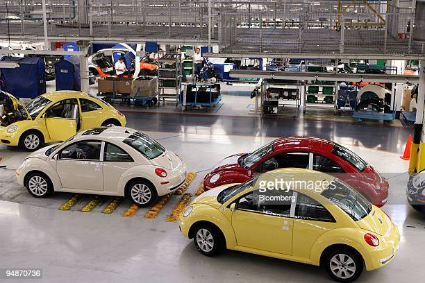Volkswagen AG Beetle cars wait to be driven out of the Volkswagen AG plant in Puebla Mexico on Thursday March 27 2008 Mexico's manufacturing index in...
