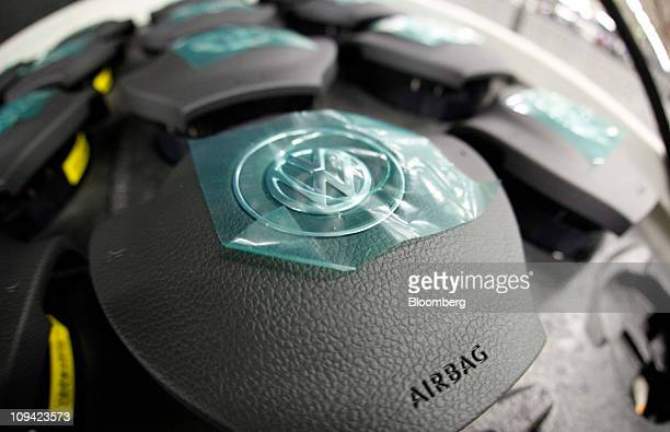 Volkswagen AG branded airbag units sit on display at the company's factory in Wolfsburg Germany on Friday Feb 25 2011 Volkswagen AG Europe's biggest...