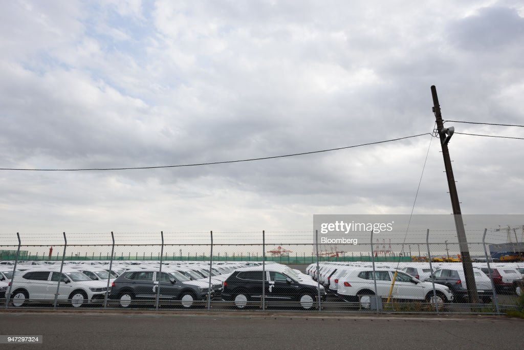 Volkswagen AG sport utility vehicles (SUV) bound for shipment stand at a port in Yokohama, Japan, on Monday, April 16, 2018. Japan and China held their first high-level economic dialogue in almost eight years on April 16 against a backdrop of trade threats from the U.S. Photographer: Akio Kon/Bloomberg via Getty Images