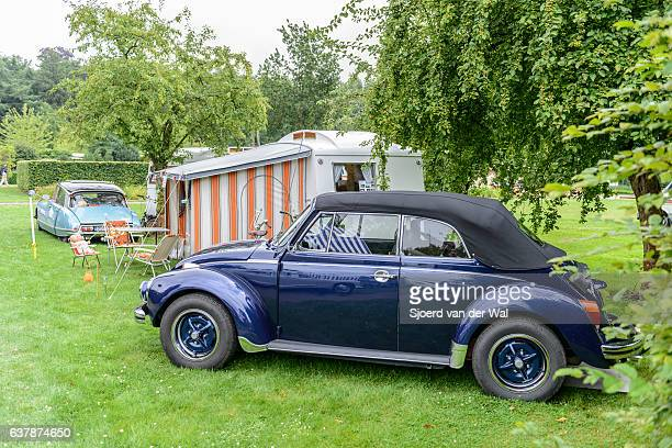 "volkswagen beetle cabriolet convertible car with a caravan - ""sjoerd van der wal"" stock pictures, royalty-free photos & images"