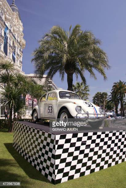 A Volkswagen Beetle car is on display in front of the Carlton hotel on the eve of the start of the 58th edition of the Cannes Film Festival 10 May...