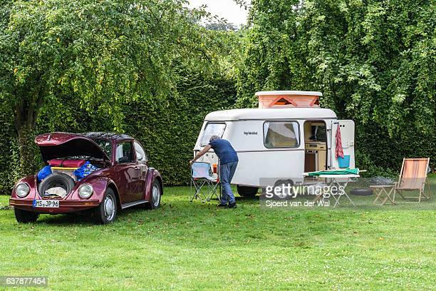 "volkswagen beetle classic car with a caravan - ""sjoerd van der wal"" stock pictures, royalty-free photos & images"
