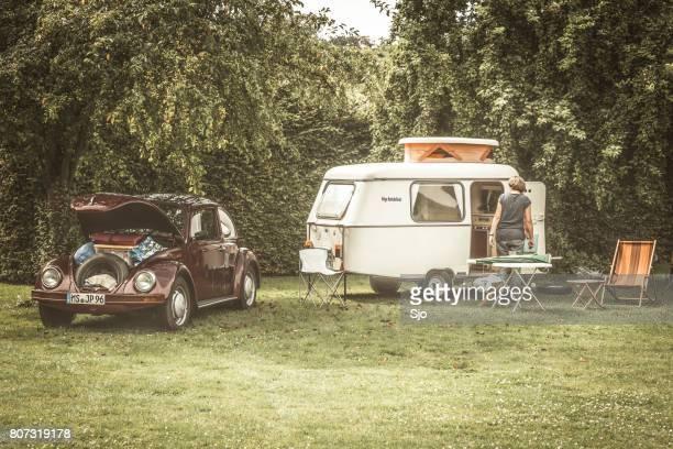 Volkswagen Beetle classic car with a caravan