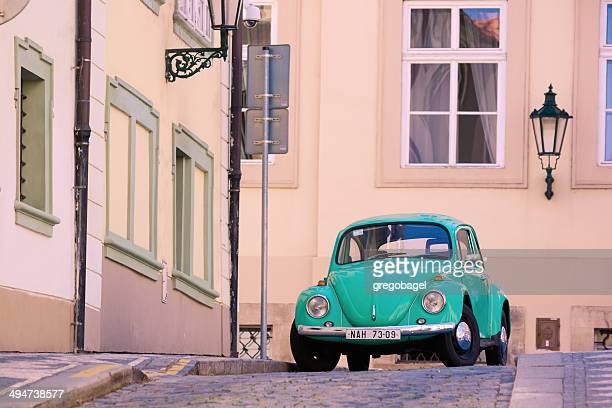 volkswagen beetle on streets of prague, czech republic - volkswagen beetle stock photos and pictures