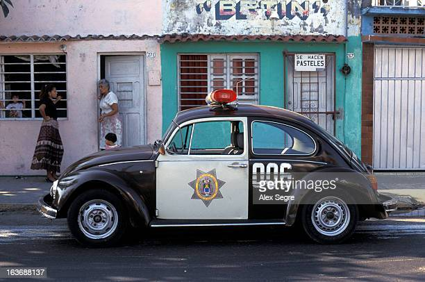 CONTENT] Volkswagen Beetle police car parked on residential street in city of Veracruz Mexico