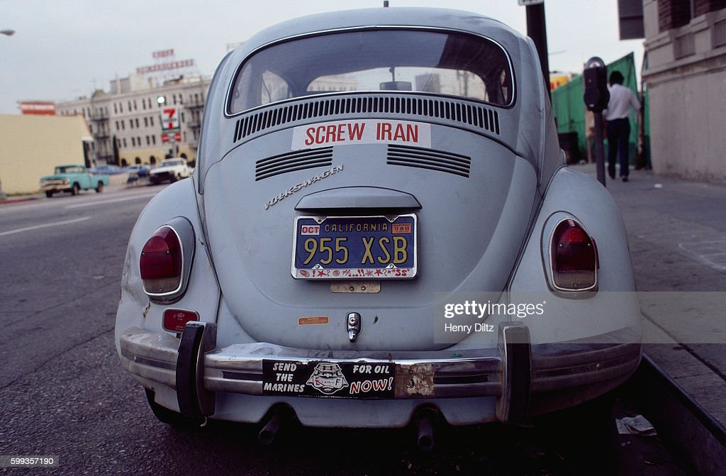 A volkswagen beetle with a screw iran bumper sticker on the trunck in 1980 tensions