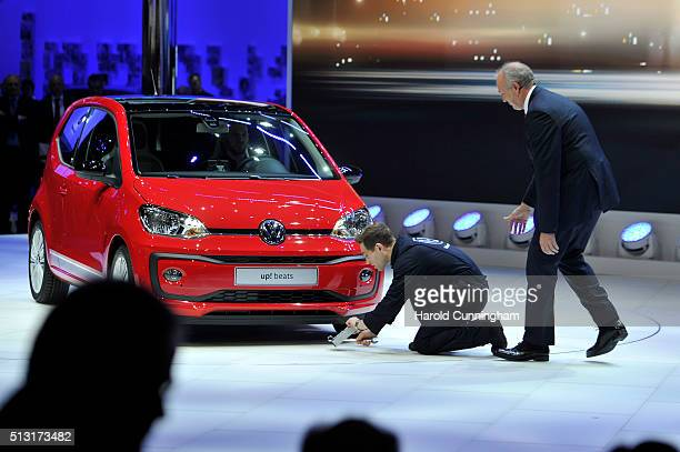 Volkswagen Board member Juergen Stackmann looks on as comedian Simon Brodkin disrupts the Volkswagen press conference during the n March 1, 2016 in...