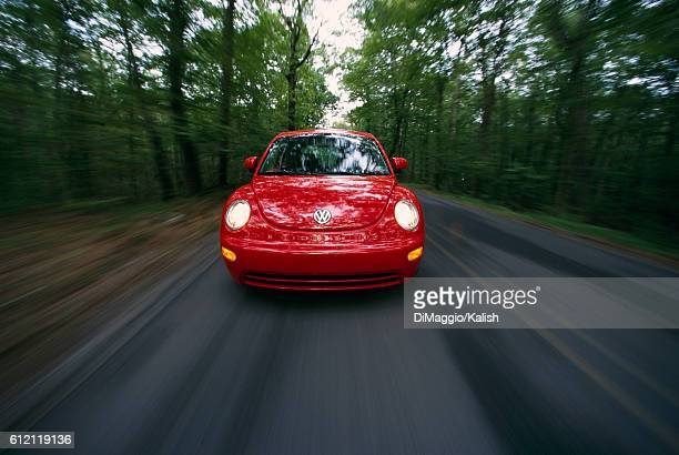 Volkswagen Bug Speeding Down Road