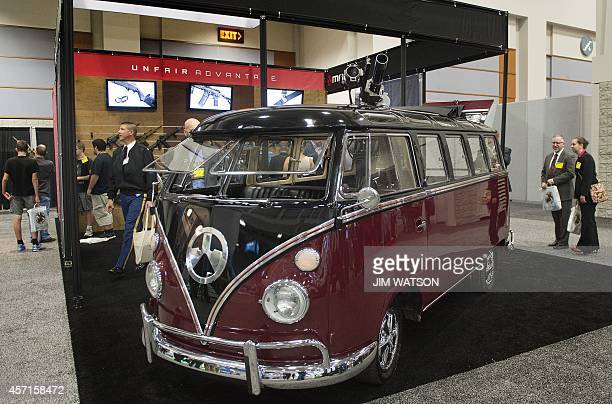 Volkswagen Bus modified to hold a machine gun on display at the Magpul weapons booth during the Association of the United States Army Annual Meeting...