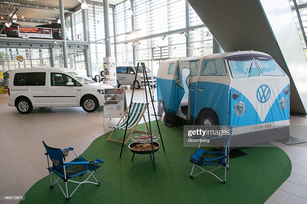 A Volkswagen (VW) c&er van shaped tent sits beside c&ing equipment inside the Volkswagen & Inside A Volkswagen AG Showroom As Domestic Sales Grow Photos and ...