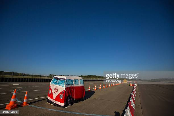 A Volkswagen camper van shaped tent stands between road traffic cones during an automated driving exercise on a test track at the new Robert Bosch...