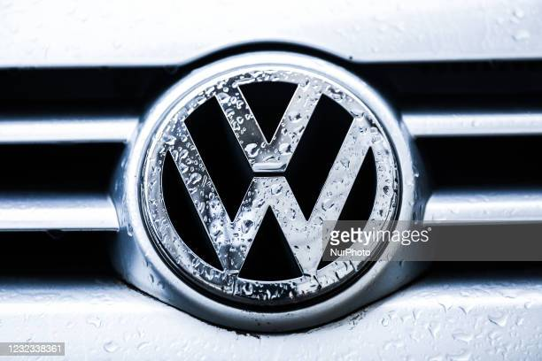 Volkswagen car emblem is covered with raindrops. Krakow, Poland on April 16, 2021