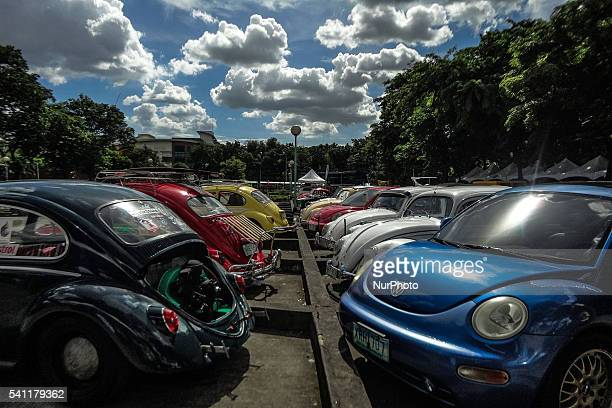 Volkswagen cars of differing models are on display during the celebration of World Volkswagen Day in Quezon City east of Manila Philippines on Sunday...