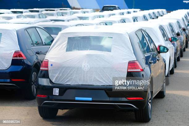 Volkswagen cars wait to be shipped at the harbour in Bremerhaven nothern Germany on June 1 2018