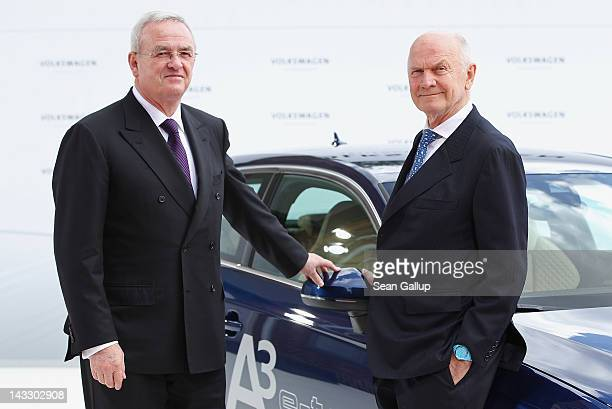 Volkswagen Chairman of the Supervisory Board Ferdinand Piech and Volkswagen CEO Martin Winterkorn stand next to an Audi A3 electric car while waiting...