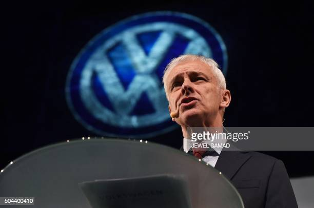Volkswagen chief executive Matthias Mueller speaks during a press event on the eve of the official press preview of 2016 North American International...