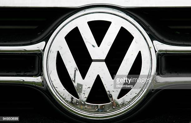 Volkswagen emblem is displayed on a new car at Southern States Volkswagen in Raleigh North Carolina US on Wednesday April 1 2009 Porsche SE 's...