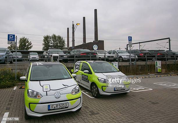 Volkswagen eMobility Cube electric car sharing hire automobiles produced by Volkswagen AG sit parked as the power plant at the Volkswagen AG...