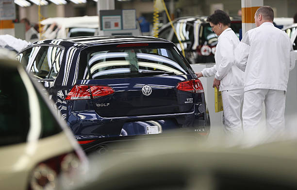 volkswagen golf vii production at wolfsburg plant photos and images getty images. Black Bedroom Furniture Sets. Home Design Ideas
