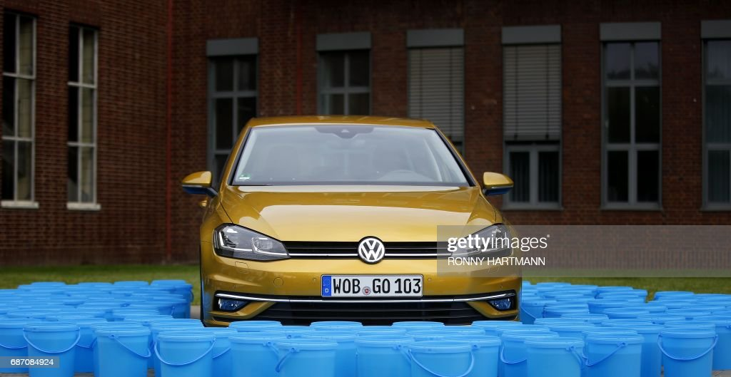 A Volkswagen Golf 7 Automobile Frames By 114 Plastic Buckets, Each Filled  With Ten Liters