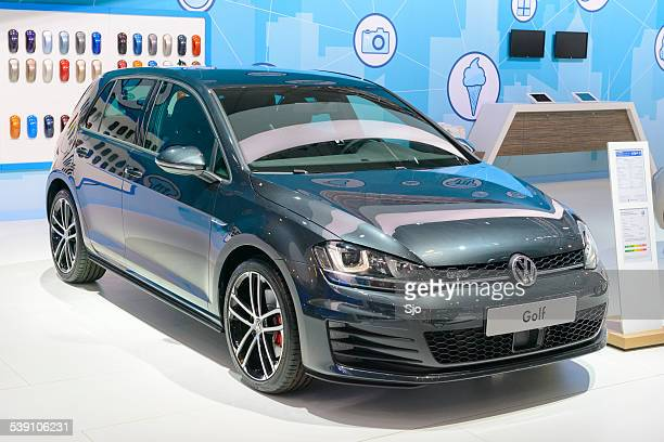 volkswagen golf at the vw stand - volkswagen golf gti stock photos and pictures