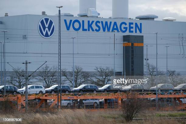 Volkswagen Golf cars stand on railway cars at the Volkswagen factory on February 25, 2020 in Zwickau, Germany. Volkswagen is gradually revving up...