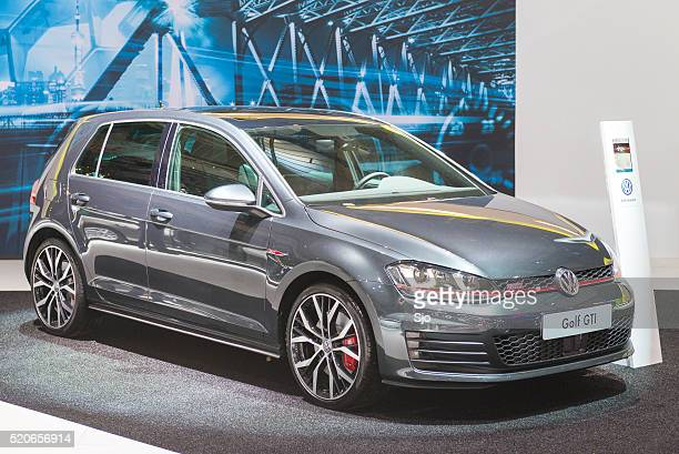 volkswagen golf gti at the vw stand - volkswagen golf gti stock photos and pictures