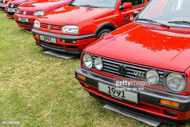 volkswagen golf gti hatchback sports car - volkswagen golf gti stock photos and pictures
