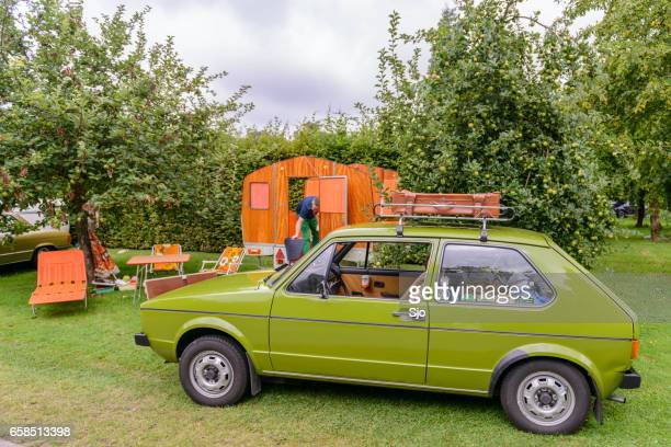 volkswagen golf mark i hatchback car with a caravan - volkswagen golf gti stock photos and pictures