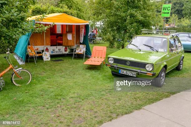 volkswagen golf mark i hatchback car with a caravan - golf imagens e fotografias de stock