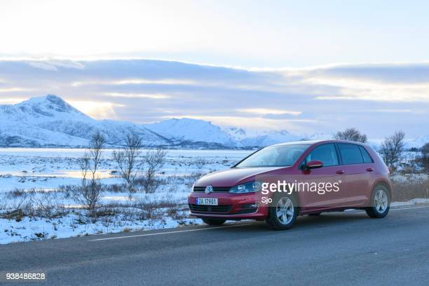 volkswagen golf mk7 hatchback car in a winter landscape - north stock pictures, royalty-free photos & images