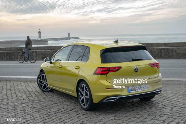 volkswagen golf on a parking - golf imagens e fotografias de stock
