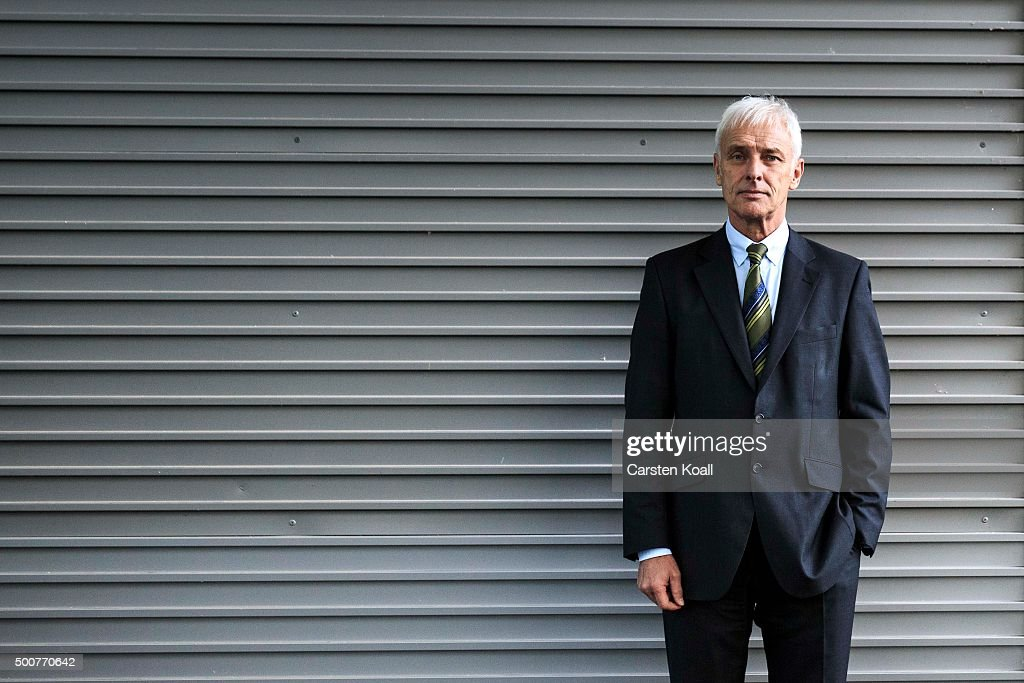 Volkswagen Group Chairman Matthias Mueller poses for a photograph after a press conference to announce the latest update in the company's handling of the engine emissions scandal on December 10, 2015 in Wolfsburg, Germany. Volkswagen is continuing to grapple with the consequences after it admitted installing software that cheats during emissions tests into 11 million of its diesel cars sold worldwide.