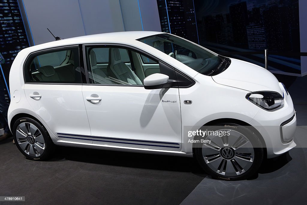 A Volkswagen hybrid electric twin-up! automobile sits on display at the Electric Mobility Week (e-Mobilitaetswochen), a public Volkswagen (VW) event at the former Tempelhof airport, on March 15, 2014 in Berlin, Germany. The event was designed to promote the company's e-Golf und e-up! automobiles, as well as its other alternative energy powered vehicles.