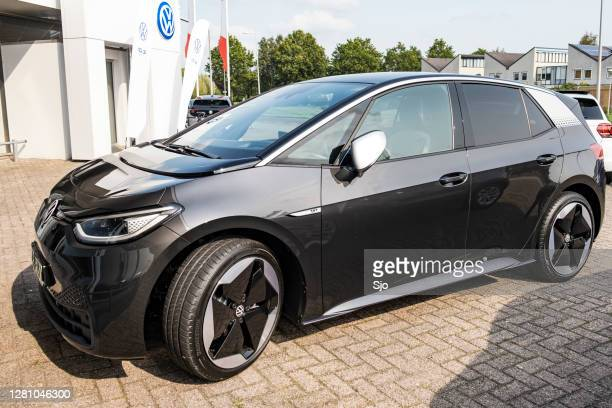 "volkswagen id.3 all electric compact car parked outside a dealership - ""sjoerd van der wal"" or ""sjo"" stock pictures, royalty-free photos & images"