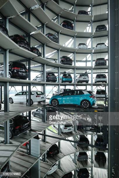 Volkswagen ID.3 electric car stands on an elevator platform inside one of the twin towers used as storage at the Autostadt promotional facility next...