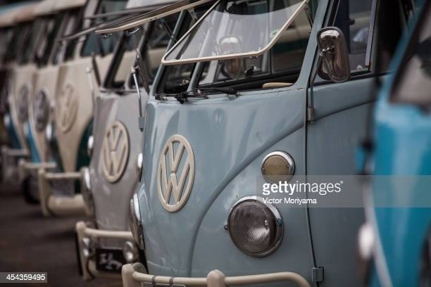 Volkswagen Kombi minibuses are lined up during an exhibition of the vehicles on December 8 2013 in Sao Bernardo do Campo Brazil The event celebrates...