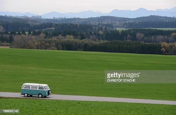 Volkswagen Kombi owner Wanja Fuhrmann drives his Volkswagen T2 camper van built in the year 1975 on a road near Landsberg, southern Germany, on...