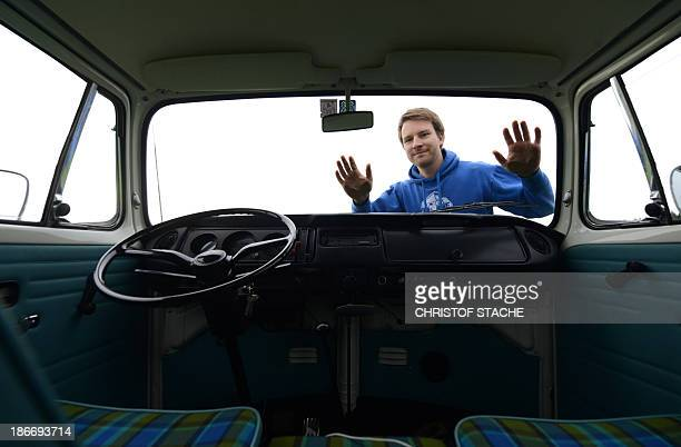 Volkswagen Kombi owner Wanja Fuhrmann poses in front of his Volkswagen T2 camper van built in the year 1975 near Landsberg, southern Germany, on...