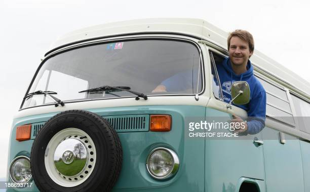 Volkswagen Kombi owner Wanja Fuhrmann poses inside his Volkswagen T2 camper van built in the year 1975 near Landsberg, southern Germany, on November...