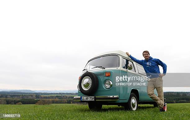 Volkswagen Kombi owner Wanja Fuhrmann poses next to his Volkswagen T2 camper van built in the year 1975 near Landsberg, southern Germany, on November...