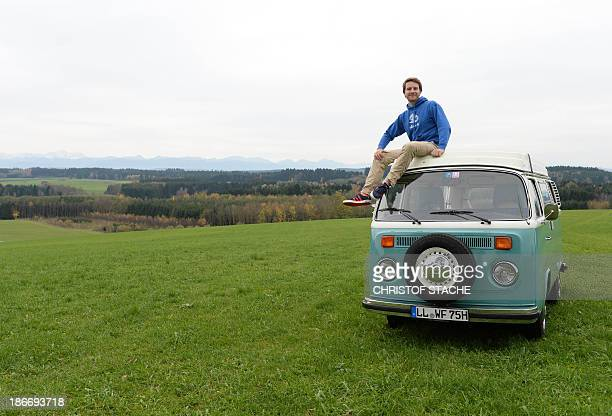 Volkswagen Kombi owner Wanja Fuhrmann poses on his Volkswagen T2 camper van built in the year 1975 near Landsberg, southern Germany, on November 1,...