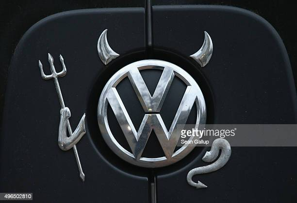 Volkswagen logo adorned with horns a pitchfork and a tail and in the guise of a devil decorates a Volkswagen passenger van on November 10 2015 in...