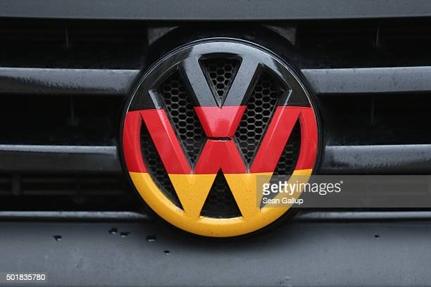 Volkswagen logo and hood ornament in the colors of the German flag is visible on the front grille of a car on December 17 2015 in Berlin Germany...