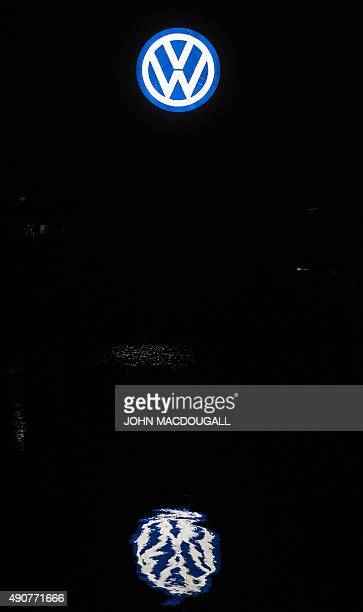 A Volkswagen logo at the company's headquarters in Wolfsburg central Germany is reflected in the waters of the Mittelland canal on September 30 2015...